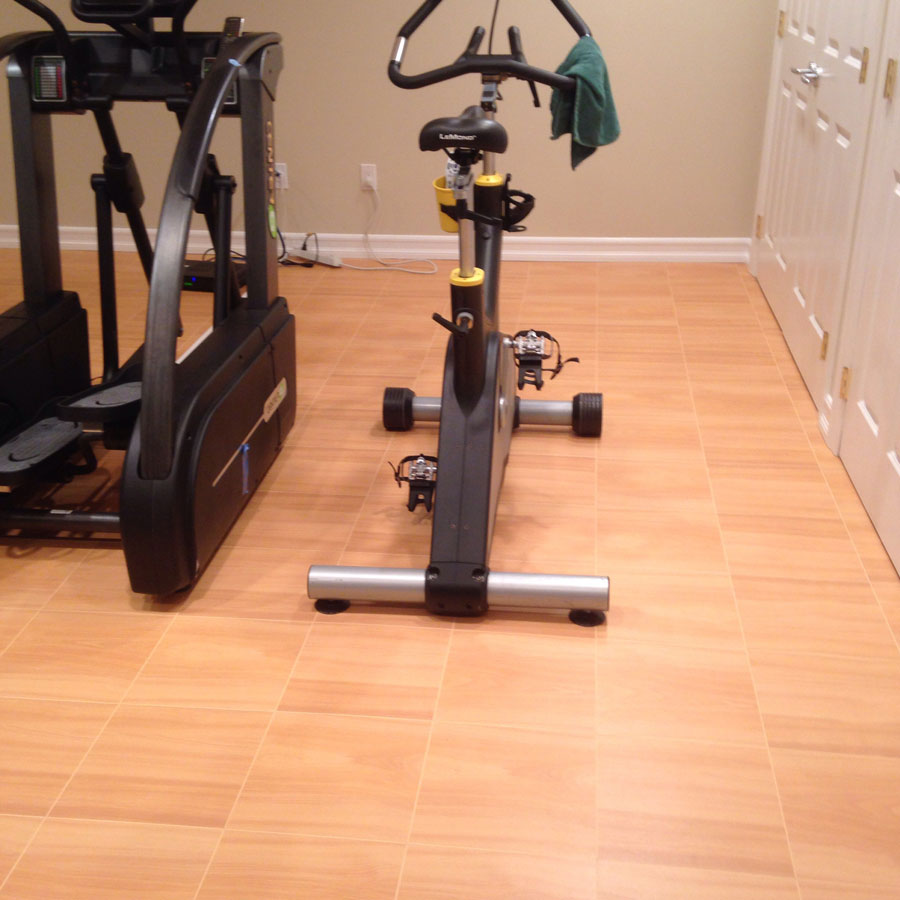 Max Tile Raised Modular Floor Tile exercise bike.