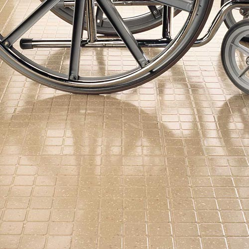 Burke Flecksibles rubber floor tiles showing a wheelchair