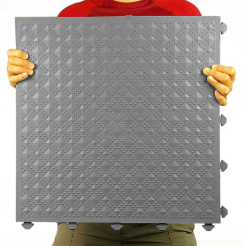Comfort Matta Solid Surface Colors gray surface texture held by person.