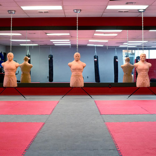 MMA Mats showing red gray studio.