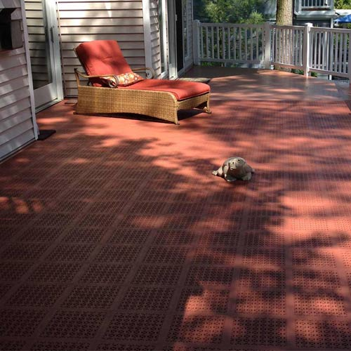 Staylock Perforated Floor Tile exterior deck installation terra cotta color.