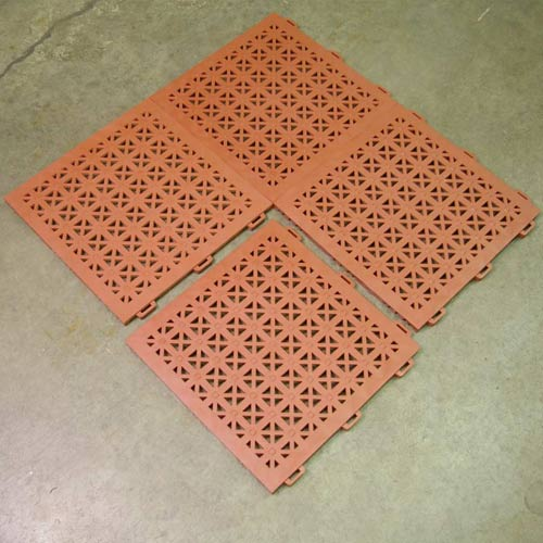StayLock Perforated Colors four tiles on cement.