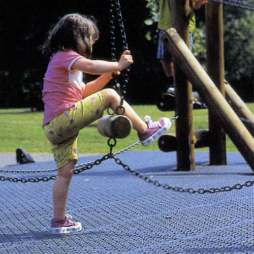 Ergo Matta Perforated - large holes showing girl on playground.