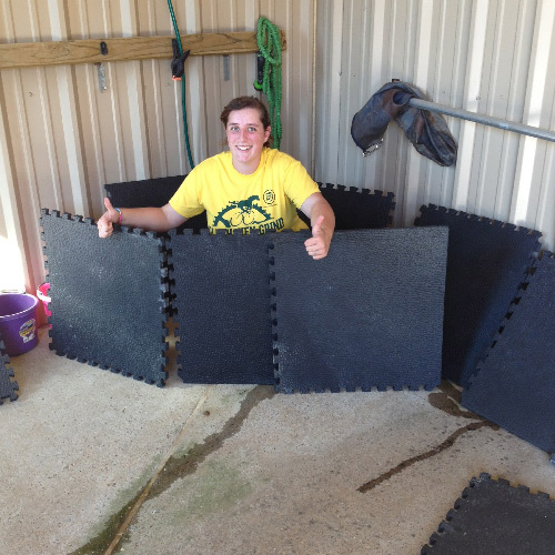 Portable Horse Stall Mats showing customer with the mats.