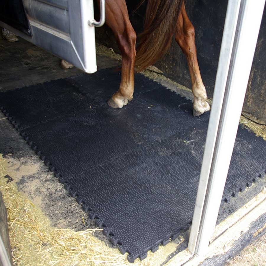 Portable Horse Stall Mats showing horse mat installation.
